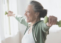 Older woman exercising with light weights.