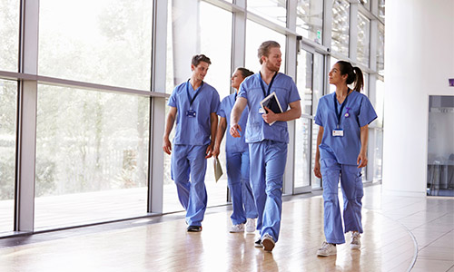 image of medical professionals walking